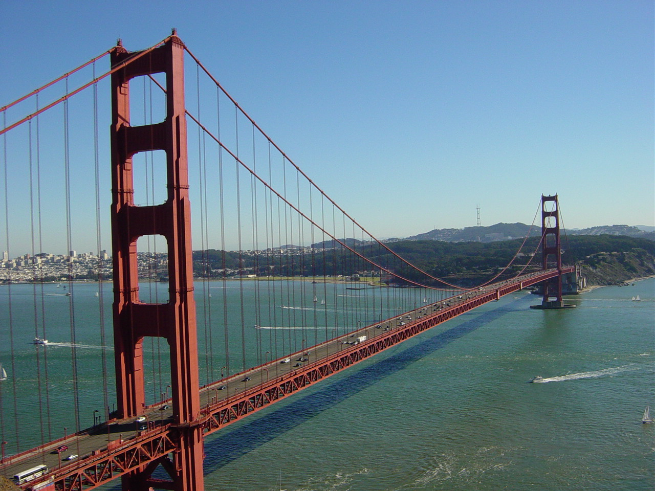 The Golden Gate Bridge is a suspension bridge, the one-mile-wide (1.6 km), three-mile-long (4.8 km) channel between San Francisco Bay and the Pacific Ocean. The structure links the U.S. city of San Francisco, on the northern tip of the San Francisco Peninsula, to Marin County.